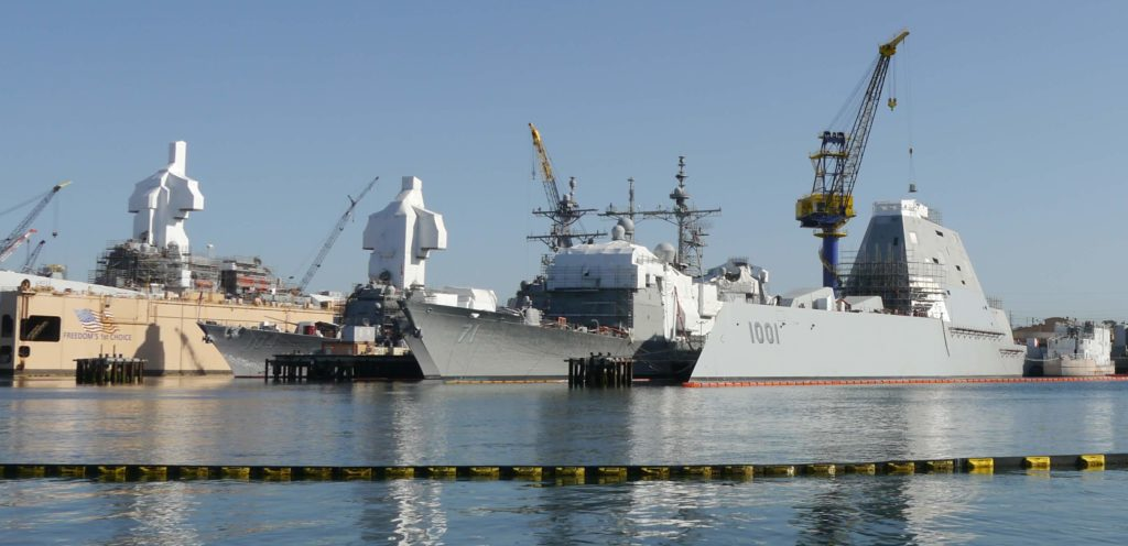 USS Michael Monsoor (DDG-1001), USS Cape St. George (CG-71), and USS Sterett (DG-104) docked and undergoing maintenance in Naval Base San Diego.