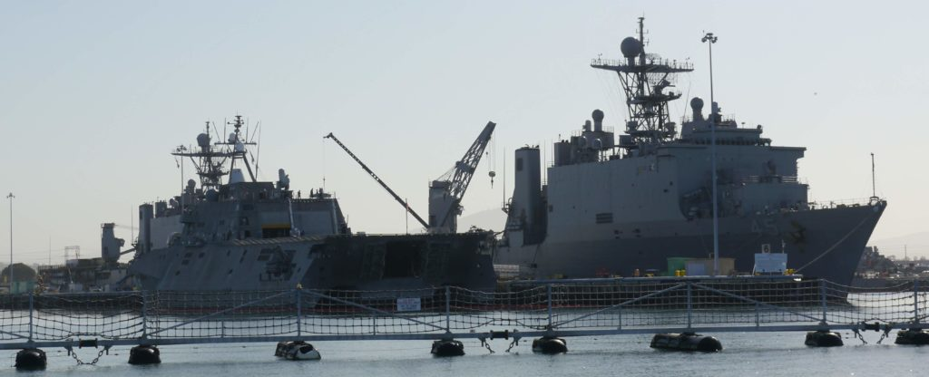USS Independence (LCS-2) and USS Comstock (LSD-45) docked in Naval Base San Diego.